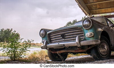 old abandoned car - ancient rusty car abandoned under a...