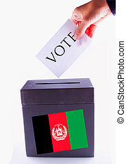 Afghanistan Urn for vote - Urn for vote, with male hand...