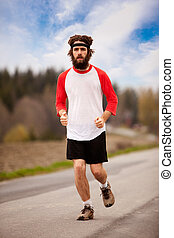Tired Jogger - A tired retro style jogger running on a road...