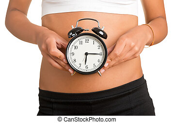 Biological Clock - Concept of biological clock Woman holding...