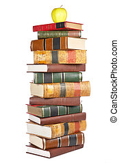 Pile of books - Apple on the pile of books isolated isolated...