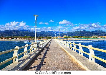 Pier, beach and Apuane mountains in Forte dei Marmi Versilia...