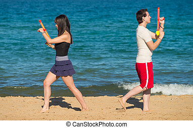 Water gun duel - Couple walking away from each other to...