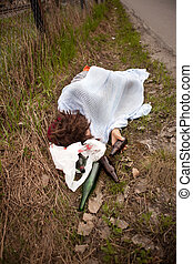 Sleeping in Ditch - A homeless person sleeping in the ditch