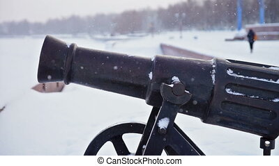 Winter view of Onega lake quay and old cannon, slider -...