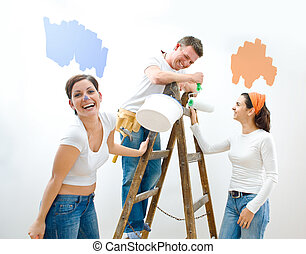 Home improvement - Young couple and friend improving their...