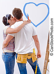 Home improvement - Young couple improving new home.