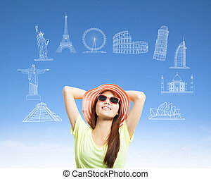 sunny woman backpacker with worldwide famous landmark
