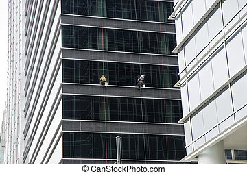 Window Washers on City Building - Window washers working...