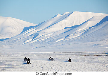 Snowmobile in Svalbard - A group of snowmobiles on the ice...