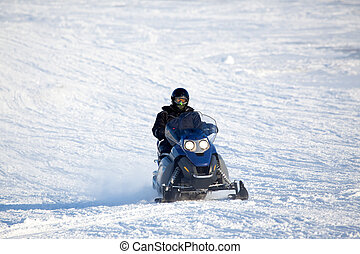 Snowmobile - A snowmobile isolated against a winter snow...