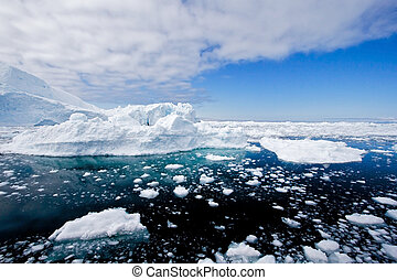 Iceberg 2 - Icebergs in a wide perspective in the fiord of...