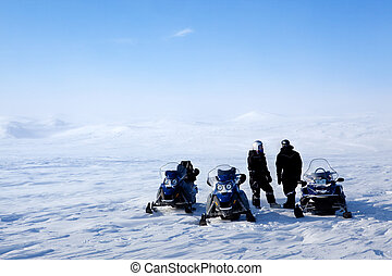 Snowmobile Expedition - A barren winter landscape with a...