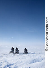 Snowmobile Winter Landscape - Three snowmobiles on a winter...