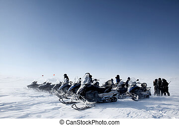 Snowmobile Group - A group of snowmobiles travelling accross...