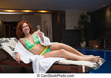 Woman enjoying wellness and spa swimming pool