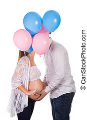 Kissing pregnant couple - Happy pregnant couple holding...