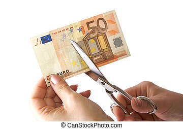 Economy cut - The female hand cuts the banknote with...