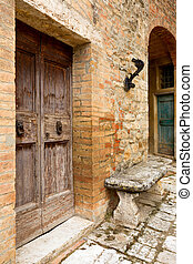 Old door in Tuscany - Old doors and door knockers in the...