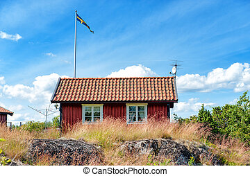 Summer in Sweden - Traditional red little cottage at...