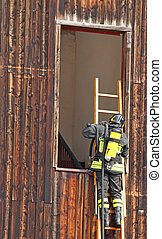 Firefighter with ladder and the oxygen cylinder enters in...