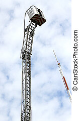 mobile platform completely extended upwards with a ladder of...