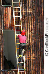 intrepid head of firefighters climbing a ladder during a...