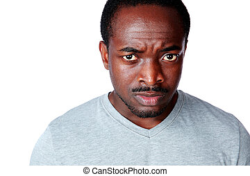 Portrait of a dissatisfied african man over white background