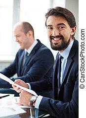 White collar worker - Image of young businessman working...