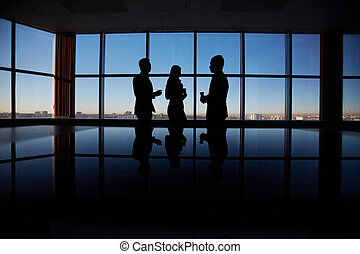Business conversation - Outlines of group of white collar...