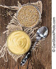 Mustard (on wooden background) - Portion of Mustard (on...