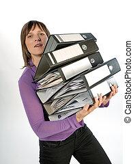 Businesswoman carrying folders