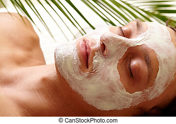 Clearing skin - Young man with closed eyes having pore...