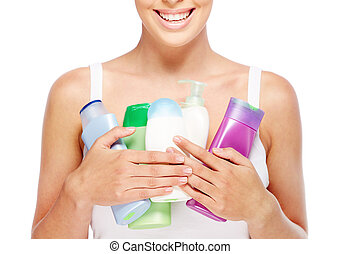 Skin nutrition - Close-up of young woman holding containers...