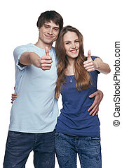 Happy couple with thumbs up sign isolated on white...