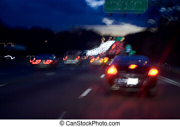 Driving traffic - View of the freeway at dusk