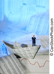 Paper ship with businessman - A model figure of a...
