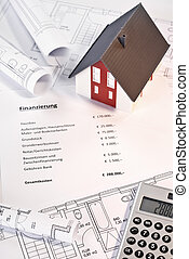Financing of a property - House, blueprints, calculator and...