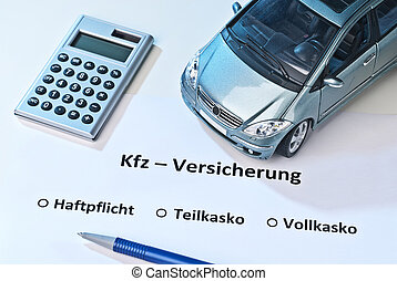 Car insurance - Car, calculator and pen on a paper with the...