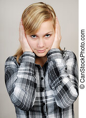 Nothing hear - Young woman holding her ears in order not to...