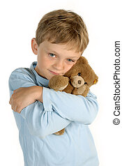 Boy with stuffed animal - Boy holding his stuffed animal in...