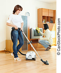 amicable couple doing housework together in home