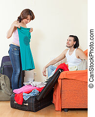 couple together choosing clothes for vacation - Happy couple...