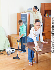 Boy with parents dusting together - Teenager boy with...