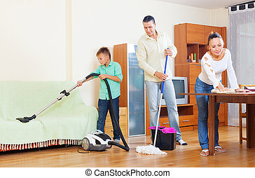 couple with teenage son doing house cleaning - middle-aged...