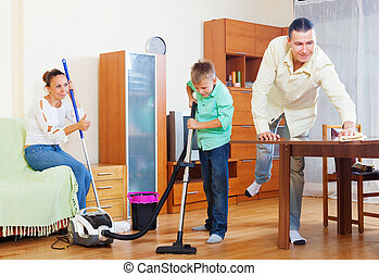 family of three doing housework together - family of three...