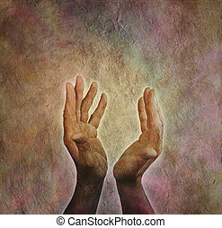 Male hands outstretched with parchm - Male healing hands...