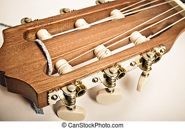 guitar fingerboard macro on a grey background