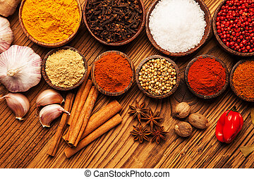 Spices and herbs in wooden bowls. Food and cuisine...
