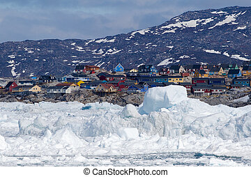 Ilulissat, Greenland, seen from the sea - The city of...